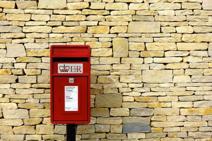 Royal Mail transformation behind schedule, UK letter outlook 'challenging'