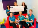 Insurance broker makes generous donation to charity Image