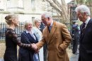 Prince of Wales visits Gloucester business - wearing one of their products Image